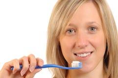 Denti di pulizia fotografie stock