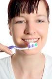 Denti di spazzolatura Fotografia Stock