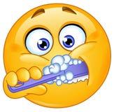 Denti di spazzolatura dell'emoticon Fotografia Stock Libera da Diritti