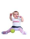 Denti di spazzolatura della giovane neonata e mela verde fresca immagini stock libere da diritti