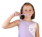 Dentición que aplica con brocha Imágenes de archivo libres de regalías