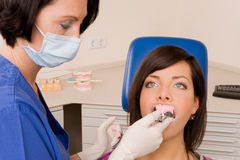 Dentist. A doctor with her patient Stock Photos