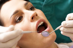 At the Dentist. Young woman at the dentist Stock Photography