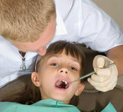 Dentist. The little girl on reception at the dentist Royalty Free Stock Photo