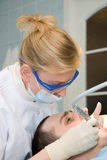 Dentist. Medical treatment at the dentist office Royalty Free Stock Photo