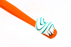 Dentist. Orange color toothbrush dentifrice white background isolate royalty free stock photos