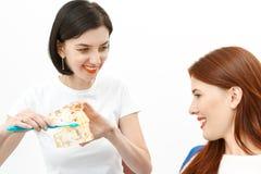 Dentist advising the customer. Female dentist advising the customer in dental office Royalty Free Stock Photos