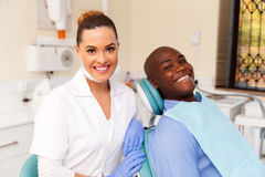 Dentist and african patient Royalty Free Stock Images