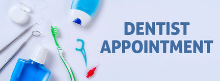 Dentist appointment. Oral care products on a light background - Dentist appointment royalty free stock images