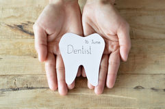 Dentist appointment in paper cuts tooth shape in woman hand Stock Image
