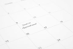 Dentist Appointment Reminder. A reminder is wrote on a calendar to go to the dentist appointment Royalty Free Stock Photos
