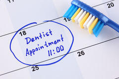 Dentist appointment. Reminder Dentist appointment 11-00 in calendar with toothbrush stock photography
