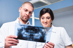 Dentist and assistant at clinic Stock Photos