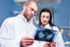 Dentist and assistant at clinic Royalty Free Stock Image