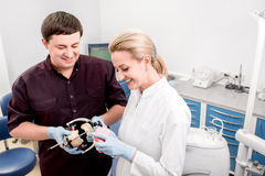 Dentist with assistant in the dental office Stock Images