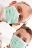 Dentist, Assistant and drill in a treatment Stock Photos