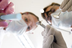 Dentist and assistant holding pick and mirror Royalty Free Stock Photos