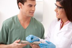 Dentist with Assistant Stock Images