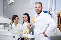 Dentist with assistant and patient Stock Photo