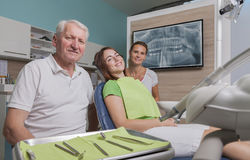 Dentist assistant and patient in the treatment room Royalty Free Stock Photography