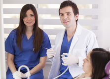 Dentist and assistant at work Royalty Free Stock Photos