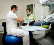 Dentist and assistant working on patient Royalty Free Stock Photography