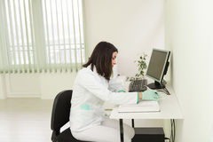 Dentist Assistant Writes Some Notes In Medical Book Royalty Free Stock Images