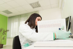 Dentist Assistant Writes Some Notes In Medical Book Stock Photos