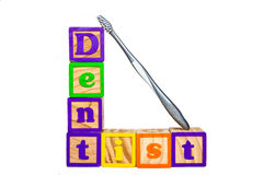 Dentist blocks and toothbrush. Royalty Free Stock Photography