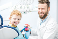 Dentist with boy at the dental office Royalty Free Stock Photography