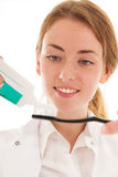 Dentist with brush and tooth paste Royalty Free Stock Photos