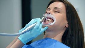 Dentist Brushing Teeth. Woman Dentist Brushing Her Teeth To Patient Before Installing Braces stock footage