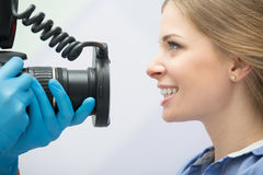 Dentist with camera and patient Royalty Free Stock Image