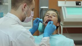 Dentist carry out routine inspection of the patient stock video