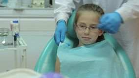 Dentist carry out routine inspection of the patient stock video footage