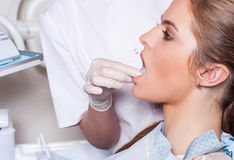 Dentist carrying out a thorough examination. Female patient. Stock Image
