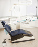 Dentist chair. A shot of a dentists office with equipment, chair and tools Royalty Free Stock Photo