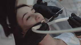 Dentist checking teeth healthe of female patient. 4K.  stock video