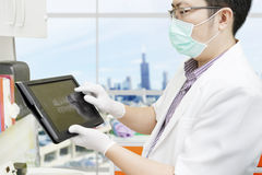 Dentist with computer tablet Stock Photos