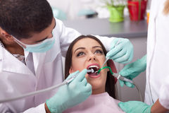 Dentist curing a girls teeth Royalty Free Stock Photography