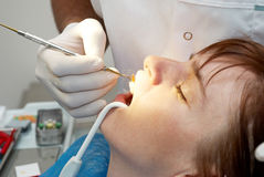 Dentist curing the patient's Royalty Free Stock Photos