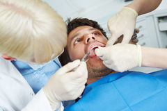 Dentist and dental assistant checking mouth Royalty Free Stock Photos