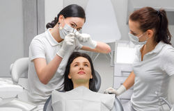 Dentist and dental assistant checkup Royalty Free Stock Images