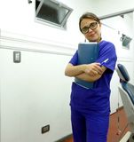 Dentist or dental assistant. With folder in her hands Royalty Free Stock Photography