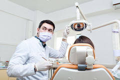 Dentist in a dental clinic. The girl on reception at the dentist's chair. Royalty Free Stock Images