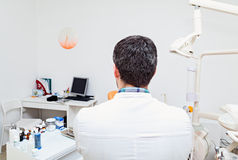 Dentist in a dental clinic. The work of the dentist. Stock Photos