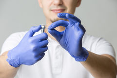 Dentist with dental handpiece Stock Images