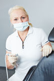 Dentist with dental turbine Stock Photography