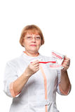 Dentist with denture for demonstration Royalty Free Stock Image