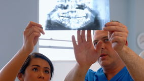 Dentist discussing patients teeth xray stock footage